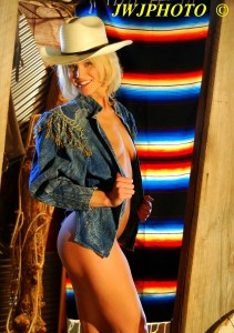 Cowgirl In Barn